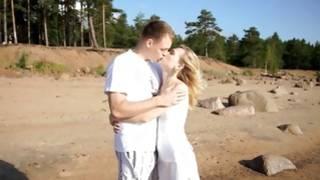 Blonde slut is kissed by indecent man on beach