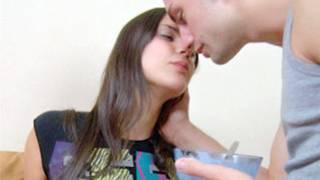 Cute and lustful man passionately kissing pretty and obscene girlfriend