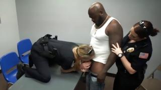 Mad wenches in police uniform sucking in pitch-black lollipop