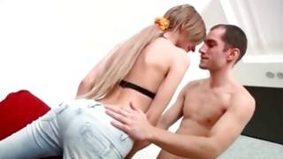 Horny guy is taking the pants off her ass cheeks